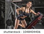 attractive fitness woman ... | Shutterstock . vector #1048404406