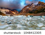 cerro torre coming out from the ... | Shutterstock . vector #1048412305