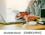 man hands using laptop and... | Shutterstock . vector #1048414942