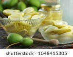 Small photo of Sweet & Sour fruits preserve, Organic mangoes conserved, Food preservation concept. Selective focus and Free space for text.