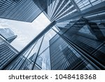 glass architecture of modern... | Shutterstock . vector #1048418368