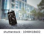 mobile phone falls on the street | Shutterstock . vector #1048418602