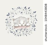 Stock photo the kitten is asleep a painted kitten with flowers 1048443808