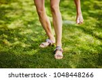 close up of young woman's legs... | Shutterstock . vector #1048448266