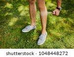 man using spray bottle of...   Shutterstock . vector #1048448272