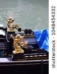 Small photo of Angel ornamentation on a Venetian Gondola prow, Venice, Italy