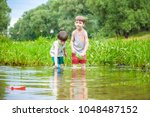 two little sibling brothers... | Shutterstock . vector #1048487152