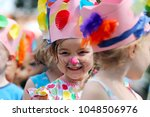Young Girl With Face Painted A...