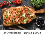 Flatbread Pizza Garnished With...