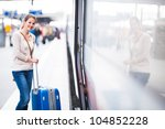 pretty young woman boarding a... | Shutterstock . vector #104852228