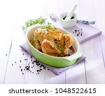 roast chicken stuffed with rice ... | Shutterstock . vector #1048522615