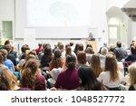 female speaker giving... | Shutterstock . vector #1048527772