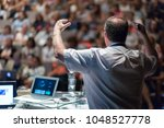 speaker giving a talk on... | Shutterstock . vector #1048527778