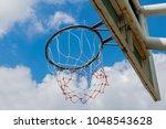 Basketball Hoop With Blue Sky...