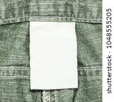 blank white fabric tag on gray... | Shutterstock . vector #1048555205