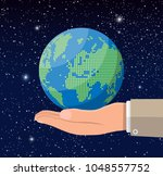 world map silhouette in hand.... | Shutterstock .eps vector #1048557752