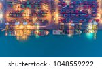 container ship in export and... | Shutterstock . vector #1048559222