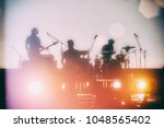 concert of a musical rock band. ... | Shutterstock . vector #1048565402