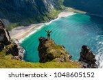 adventurous woman looking down... | Shutterstock . vector #1048605152