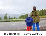 mom with the son of a look at... | Shutterstock . vector #1048610576
