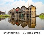 floating villages of inle lake  ... | Shutterstock . vector #1048611956
