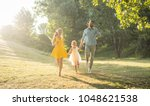 full length of two happy... | Shutterstock . vector #1048621538
