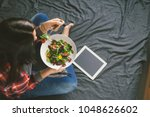 young woman eating summer salad ... | Shutterstock . vector #1048626602