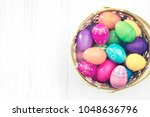 easter eggs in basket on wooden ... | Shutterstock . vector #1048636796