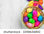 easter eggs in basket on wooden ... | Shutterstock . vector #1048636802