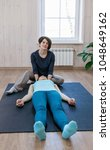 trainer doing special therapy... | Shutterstock . vector #1048649162