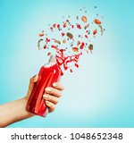 female hand holding bottle with ...   Shutterstock . vector #1048652348