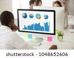 african businessman analyzing... | Shutterstock . vector #1048652606