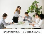 young woman leader boss giving... | Shutterstock . vector #1048652648