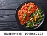 steak carne alla pizzaiola and... | Shutterstock . vector #1048662125