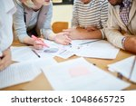 contemporary economists sitting ... | Shutterstock . vector #1048665725