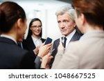 confident politician in suit... | Shutterstock . vector #1048667525