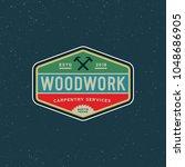 vintage carpentry logo. retro... | Shutterstock .eps vector #1048686905
