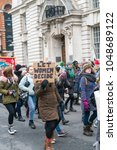 """Small photo of 18 March 2018 - London, England. Woman holding placard """"Let Women Decide"""" protesting against abortion rights in Ireland. St Patrick's parade in London."""