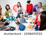 young moms with their kids | Shutterstock . vector #1048693532