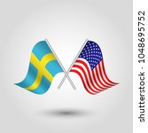 vector two crossed swedish and... | Shutterstock .eps vector #1048695752