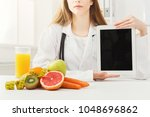 doctor nutritionist with fruits ... | Shutterstock . vector #1048696862