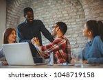 good news handshake in the...   Shutterstock . vector #1048719158