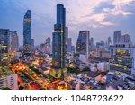 aerial view of bangkok skyline... | Shutterstock . vector #1048723622