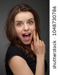 shocked and surprised girl... | Shutterstock . vector #1048730786