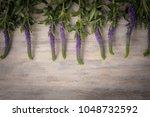 beautiful flowers  on wood... | Shutterstock . vector #1048732592