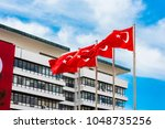 turkish flag waving in blue sky  | Shutterstock . vector #1048735256