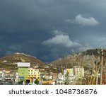 Small photo of a dark overlay of storm clouds comes in over Lezhë from the northeast in contrast to the sunshine still lighting the city; Lezhë, Albania