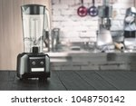blender and wooden table in... | Shutterstock . vector #1048750142