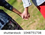 two young women in walking... | Shutterstock . vector #1048751738