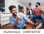 group of friends playing... | Shutterstock . vector #1048760732